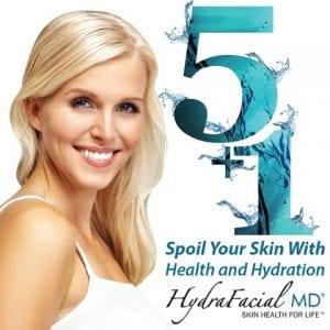 Woman next to 5+1 Hydrafacial